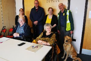 Working together...to secure better access for disabled people are (front) chairman George Williamson and vice-chairman Jennie McCartney and (back) secretary Karen Procek, Alex Smith, Diane Williamson and treasurer Michael Anderson with his guide dog Quin. (Pic: Michael Gillen)