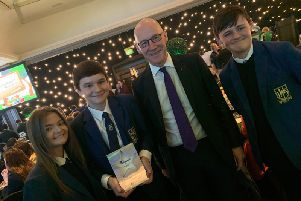 Cabinet Secretary for Education John Swinney with pupils at Larbert High School holding their 'Parents as Partners in Learning' Scottish Education award