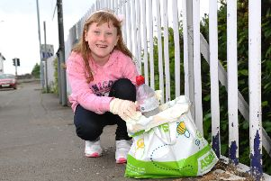 St Bernadette's Primary schoolgirl Eva Kilcoin is on a one-girl mission to clear Larbert's streets of litter, one bag of rubbish at a time. Picture: Michael Gillen