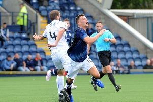 Ross Matthews is fouled by Dundee's Jamie Ness (Pic by Fife Photo Agency)