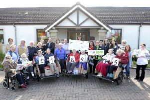 A happy day at Airthrey Care Home last year, when Asda Stenhousemuir general manager Neil Millar passed on a cheque for nearly �19,000 to buy trishaw bikes for use by the residents.