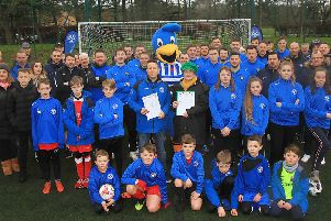 Penicuik Athletic Youth Football Club memebrs, pictured earlier this year petitioning Midlothian Council to relay the astroturf.