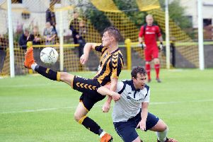 Action from Saturday's cup replay at Beechwood Park. Pic: George Wallace