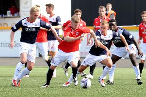 Falkirk's Craig Sibbald and Kyle Turnbull close in on Clyde's Gavin Brown during the sides' last meeting in 2013.