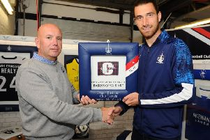 Falkirk FC captain Gregor Buchanan met with Fanatikool Ltd owner Alex Comrie at the company's new showroom in Carronshore after using its services. Pic: Michael Gillen.