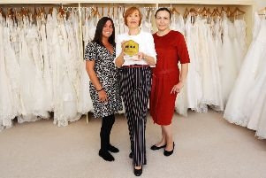 Pictured with the award are Susan Kearney, sales consultant; Fiona Smart, owner and Mariia Anaieva, bridal fitter.''Pic: Michael Gillen.