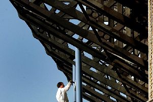 A painter painting the exterior in 2006.