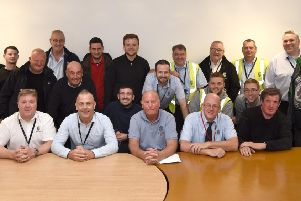 Ian McKean (front and centre), Falkirk Council's longest serving employee, was thrown a surprise presentation by his colleagues after he announced his retirement