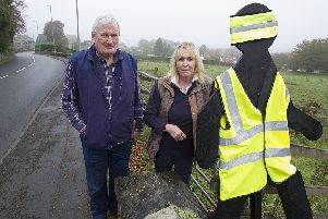 Lindsay Neil and Vivienne Nash in Selkirk's Hillside Terrace with their one remaining high vis-clad cutout.