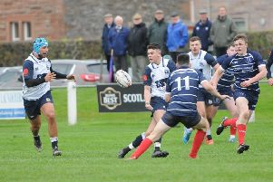 There you go ... Ryan Cottrell puts James Bett, left, through for a Selkirk try (picture by Grant Kinghorn)