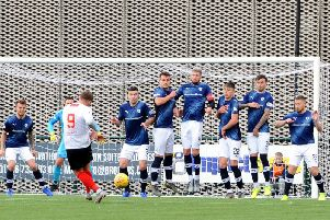 Raith Rovers defend a free-kick from Clyde striker David Goodwillie. Pic: Fife Photo Agency