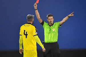Iain Davidson receives his marching orders from referee Gavin Ross. Pic: Duncan Brown
