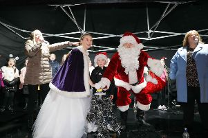 Christmas lights switch-on in Bo'ness on Saturday, November 23. Santa helps Fair Queen Kennedi Mann (12) and competition winner Mason Barr (5) switch on the lights. Picture by Jamie Forbes.