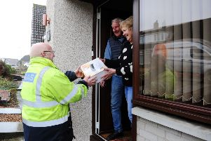 Gas engineers have been delivering electric heaters and hobs to residents.  Pic: Michael Gillen.