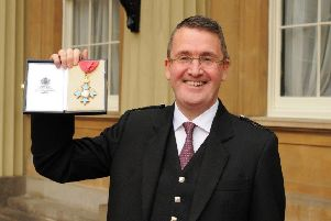 Colin Robertson, of Alexander Dennis Ltd, receives his CBE