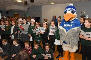 Buchanhaven School Choir is joined by club mascot Sammy the Seagull for some Christmas carol singing.