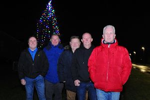 Carronshore Heritage Forum members were delighted with the number of people who turned out to see the village's Christmas tree being switched on. Picture: Michael Gillen