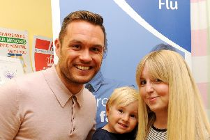 River City actor Jordan Young launches the drive to boost uptake of flu vaccine, with Albert Miller-Duff (4) and his mum Alison.
