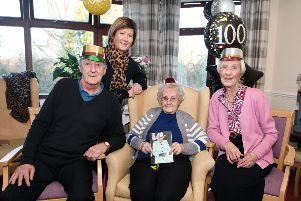 Ann Whyte marks her 100th birthday with son Alexander, daughter Janet and granddaughter Lisa.  Pic: Michael Gillen.