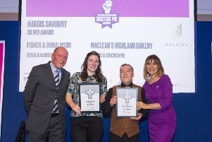 Jade Milne, second from left, with the award. Pic: Katielee Arrowsmith.
