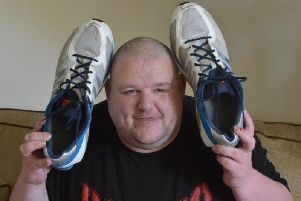 David Henderson with his size 29 trainers.