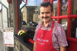 Business owner Malcolm Watson outside Nooks and Crannies shopfront in Cross Street, Fraserburgh
