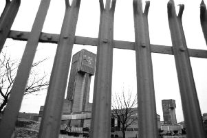 A view of the winding tower at Seafield colliery in Fife, seen through the spiked railings. Picture taken January 1988.