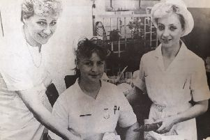 At the Victoria Hospital, Christmas 1987 are dining room supervispr Mary Haig, pupil nurse Tracy Drysedale and dining room charge hand Evelyn Hall.
