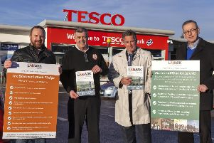 Members of the Discover Lanark BID team with their latest ally, Tesco manager Richard McAllister (2nd left)