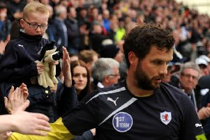 Kevin Cuthbert gives his gloves to a young Raith fan at the end of the play-off defeat to Hibs in 2016. Pic: Fife Photo Agency