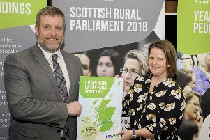 Host MSP Finlay Carson at Holyrood launch of Rural Parliament report with Rural Action's Chief Executive Emma Cooper
