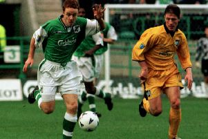 Hibs v Raith Rovers.  Chris Jackson being chased by Raith's two-goal hero John Millar. Pic: Julie Bull