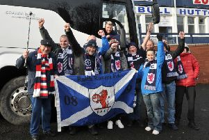 Raith have sold nine supporters buses for the trip to Hibs on Saturday.Group of supporters posing outside Bay Travel bus with player Iain Davidson. Pic: George McLuskie