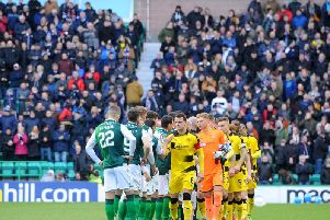 The 1700 Raith fans provide the backdrop as the teams line-up for the pre-match hand shakes. Pic: Fife Photo Agency