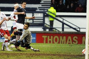 Jamie Walker equalises for Raith in the last minute against Ross County on February 11, 2012. Pic: Neil Doig