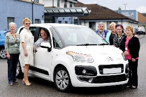 Meadowbank Car 4U chairwoman Anne McDonald (second from left) pictured with volunteers from the charity