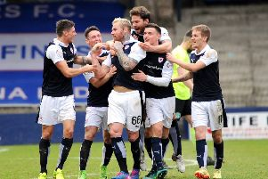 Stark's Park - Kirkcaldy - Fife -  Raith Rovers v Hibs - goalscorer Ryan Stevenson is mobbed by teammates -  credit- Fife Photo Agency