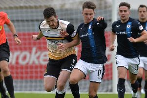 Ross Perry challenges Nathan Flanagan during Raith's 5-1 win in Dumbarton in September. Pic: Dave Johnston / Alba Pictures