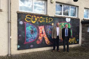 Councillors Neil Richards and, right, George Turnbull outside Hawick High School.