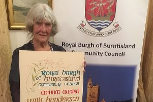 Willi Henderson with her handcrafted Community Award certificate