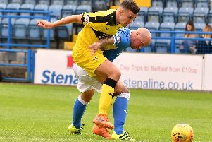 Ross Matthews competes with Jamie Hamill for possession in the first meeting between the teams this season. Pic: Eddie Doig