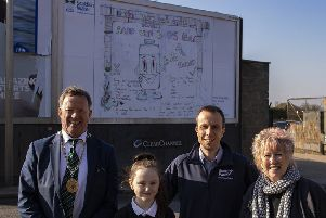 Ruby Maxwell, Christine Grahame MSP, Midlothian Provost Peter Smaill and Scott Fraser of Scottish Water in front of Ruby's winning Scottish Water poster on a Newtongrange billboard.