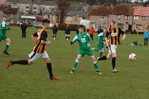 Archie Watson making the pass watched by East Fife's Jordan Lamont and Jack Matheson.