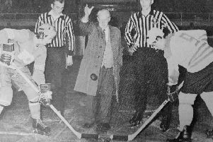 Fife Flyers 1973 - John Calderwood, aged 82 - the oldest director of Kirkcaldy Ice Rink - drops the puck at the opening game of the 1973-74 ice hockey season.