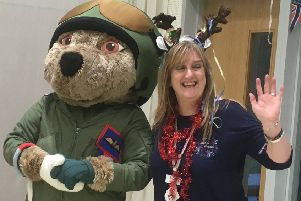 Gerry McGregor with Help for Heroes mascot Hero Bear