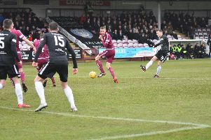 Ross Davidson tries his luck from range. Picture by Kenny Mackay