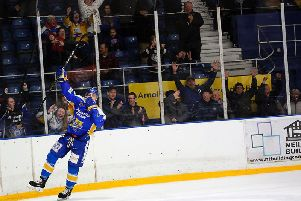 Celebrations on the ice and in the stands after Joe Basaraba struck the overtime winner. Pic: Steve Gunn