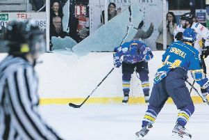 Fife Flyers Kris Hogg is showered in glass as the plexi shatters during the play-off quarter-final with Nottingham Panthers in 2013. Pic: Steve Brown