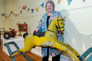 Councillor Anne Stirling with a  hand-painted wooden rocking horse dates from around 1850 and was donated to Aberdeenshire Council Museums