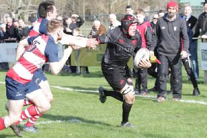 Alan Warnock evades Peebles defence to score Biggars first try in title clinching win at Peebles (Pic by Nigel Pacey)